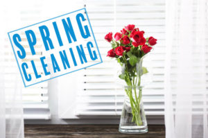 spring cleaning stamped on white blinds with red roses